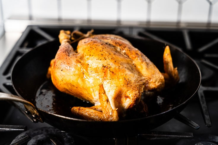 simple roast chicken in skillet on stove horizontal 3