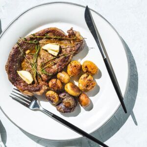 skillet rib eye steak. and potatoes horizontal