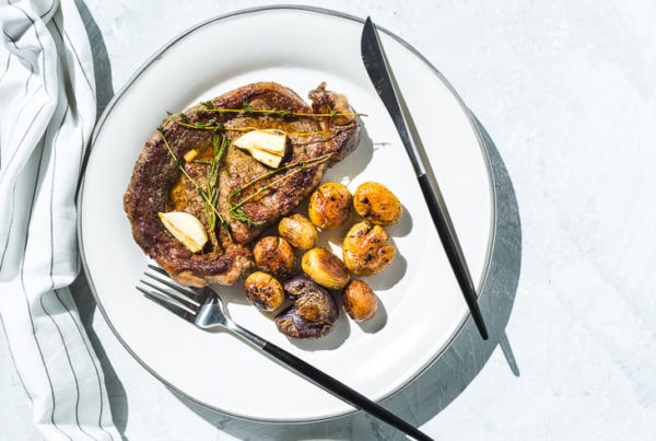skillet rib eye steak. and potatoes horizontal