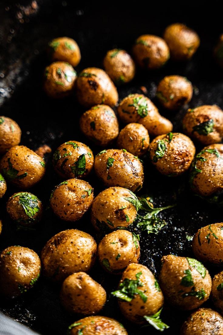 sous vide potatoes in pan close up vertical