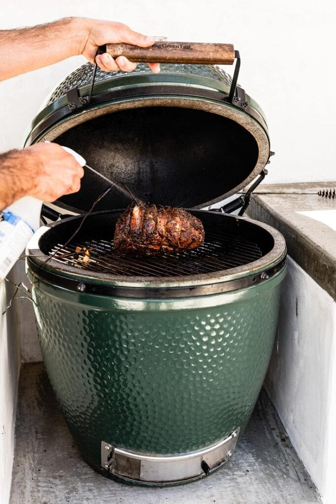 spritzing lamb shoulder in big green egg