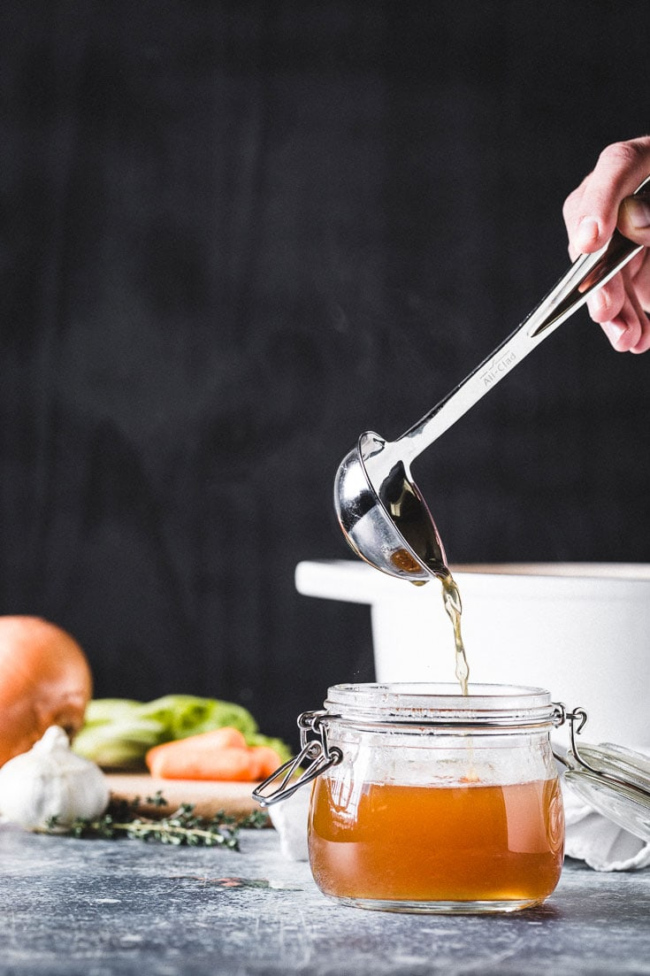 turkey stock recipe pouring with ladle