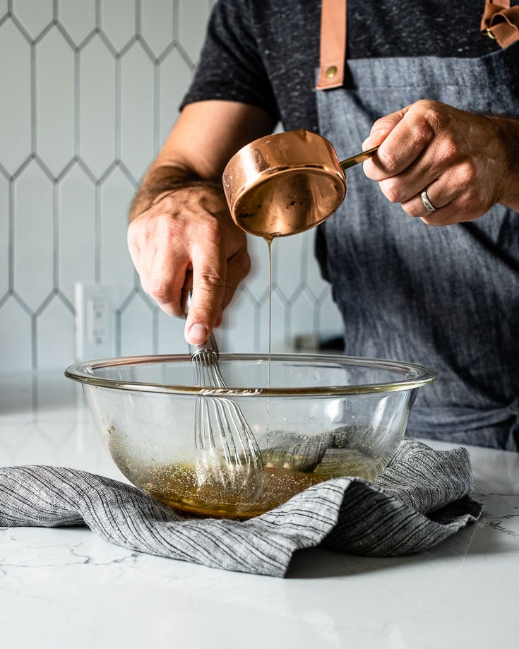 whisking vinaigrette in bowl