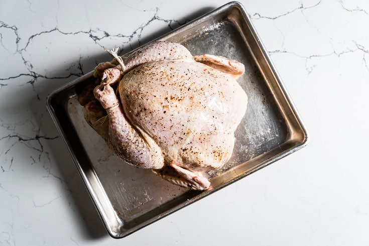 whole chicken on sheet pan for roasting